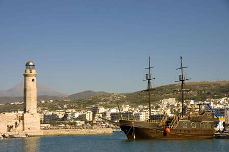 View of the harbor of Chania, Crete, Greece with the lighthouse and its typical greek schooner Imagens