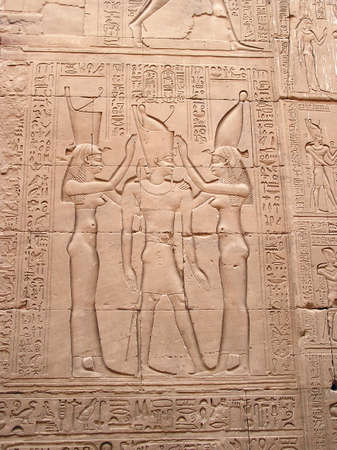 Bas-relief with goddesses,pharaoh and hieroglyphs at the bottom in Edfu temple, Egypt, Africa
