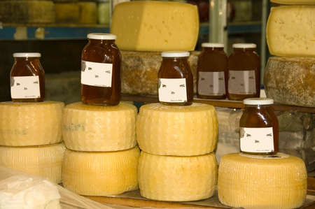display of cheeses and honey jars on a Greek market, Greece Stock Photo