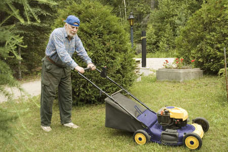 Senior mowing his lawn