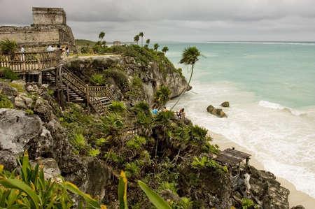 vacationing: Tourists visiting mayan ruins over the Caribbean sea ,Tulum archeological site, Yucatan Peninsula, Mexico,        Stock Photo