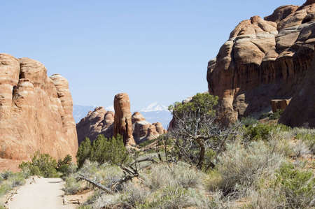 Hiking in Park Avenue  of Arches National Park on a blue sky, Utah, USA