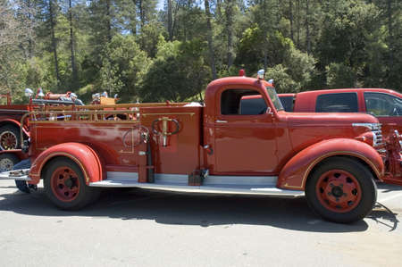 old people: antique firefighters truck 1940s year,  on parade in California Stock Photo