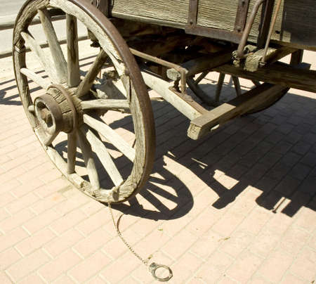 Cuffs on  a wagon wheel used to tie thieves in the old time in Montana, USA Stock Photo - 2770120
