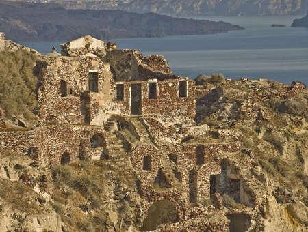 vestiges of the 1956 earthquake over the caldera in Oia Village, Crete island, Greece