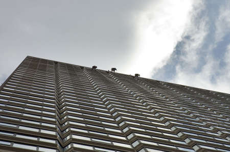 custodian: three windows washers suspendend in mid-air on the last floor of an highrise bulding, Boston, Mass