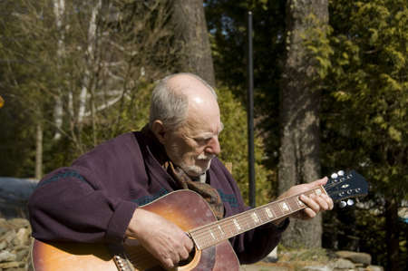 senior playing acoustic guitar Stock Photo