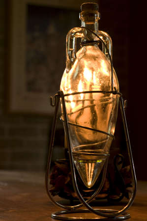 Closeup Of A Decorative Olive Oil Bottle Enlighten By Candles Mesmerizing Decorative Olive Oil Bottles