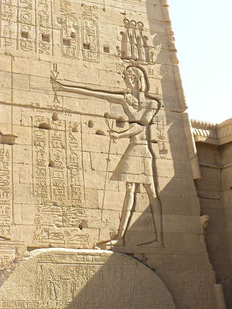 dominion: pharaoh keeping in his hand the  Flail and Crook, symbol of royalty, majesty and dominion. Philae temple, Egypt, Africa Stock Photo