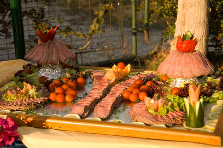 colorful presentation of slice prime rib roast, tomatoes and vegetable,