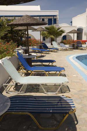 Lounge chair and parasols on the swimming pool, Crete Island Greece