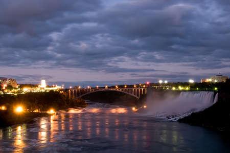 Niagara Falls at twilight with bridge to USA on background photo