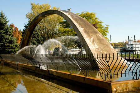unify: Confederation Arch Fountain. Arch represents the aim of fathers of Confederation to unify the provinces from Atlantic to Pacific coasts, Kingston Park, Ontario Stock Photo