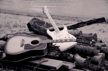 jazz and classic guitars on the beach on a pile of woods photo