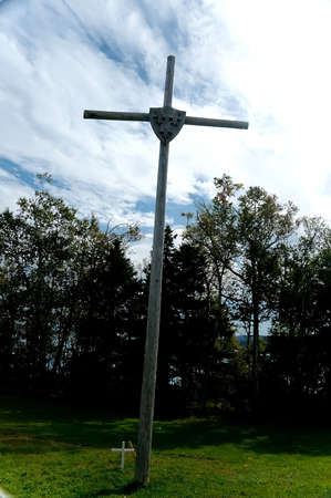 erected by Jacques Cartier who took possession Canada in 1534,  this historic cross is emblazoned with the fleur de lys. Gaspe, Quebec, Canada