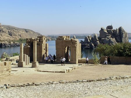 AGILKIA ISLAND, NILE RiVER,EGYPT - MARCH 2: Tourists in Philae Temples converted into a  church dedicated to the Virgin Mary, on the Agilkia island in the Nile River ,Egypt, UNESCO  World Heritage Site. 2 March 2005    Stock Photo - 6889562