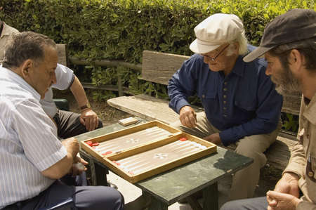 ATHENS, GREECE - MAY 18TH; Senior backgammon players in the city park by a sunny day. Athens, Greece, 18 May, 2007