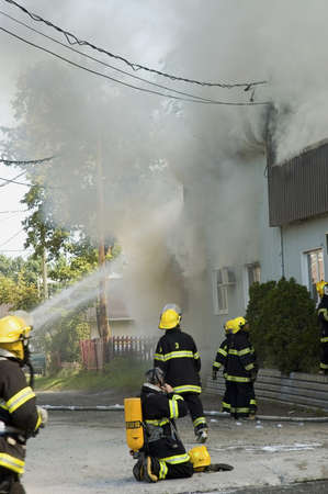 QUEBEC, CANADA - AUGUST 30TH; Firefighters on the move, fighting  burning building in a rural country, Quebec, Canada, 30 August, 2006