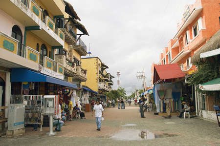 PLAYA DEL CARMEN, MEXICO - DECEMBER 12TH; Street scene with tourists and merchants showing display and stores on coasts of Playa del Carmen, Mexico, 12th December 2006