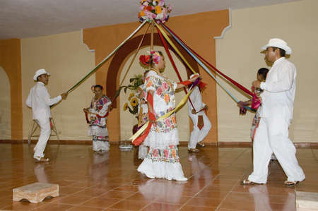 YUCATAN, MEXICO - DECEMBER 13TH; Mexican dancers performing on a stage in Yucatan peninsula, Mexico,13th December 2006