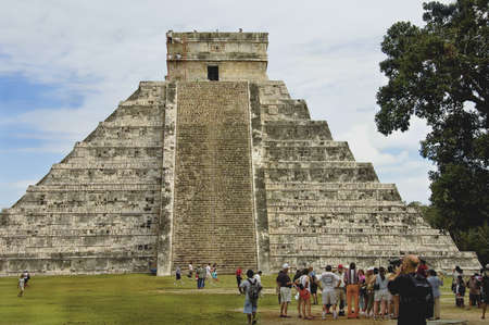 mayan calendar: CHICHEN ITZA, MEXICO - DECEMBER 13TH; Pyramid of Chichen Itza, Mexico, among the new seven wonders of the world,  The four sides of 91 stairs are the origin of Mayan Calendar. one step for each day of the year, with the 365th day represented by the platfo