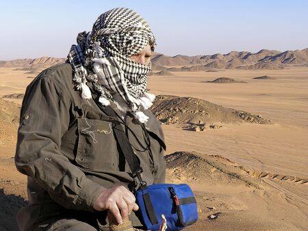 Senior tourist with  turban on Sahara desert,  Egypt, Africa