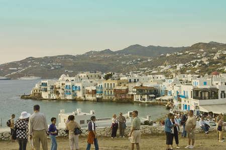 myconos: Myconos, Greece - May 7th, 2007; tourists on the beach of  the famous city of  Myconos, Greece