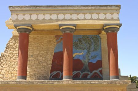 Knossos, Crete, Greece - May 12th, 2007; Front view of Knossos Palace showing bull fresco behind the columns, Crete Island,