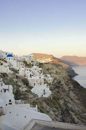 Oia ,Santorini, Greece - May 16th, 2007: Pastel colored houses and churches over the caldera of Oia village in Santorini, Greece