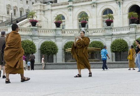 Washington DC, USA - June 25th, 2007 : monks buddhists taking pictures  in front of Capitol, Washington DC, USA Publikacyjne