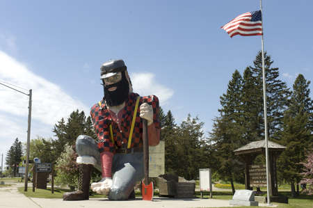 Minnesota, USA - May 19th, 2006 : side view of the statue of Paul Bunyan the giant lumberjack, mythical hero of the lumber camps, in memorial park on roadside of Akeley village, Minnesota, USA, May 19th, 2006