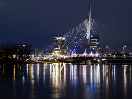night shot of Esplanade Riel pedestrian bridge Winnipeg