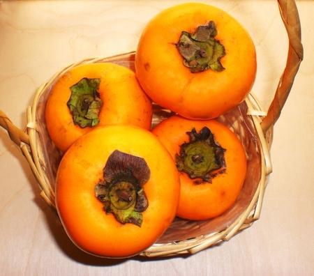Genuine fruits, ripe persimmons Archivio Fotografico