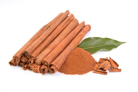 Sticks and powder of cinnamon on white backround Stock Photo - 7014613