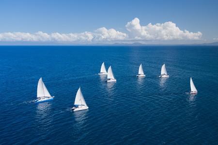 Regatta in indian ocean, sailboat and catamaran. Helicopter view