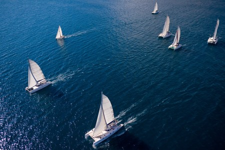cruising: Regatta in indian ocean, sailboat and catamaran. Helicopter view