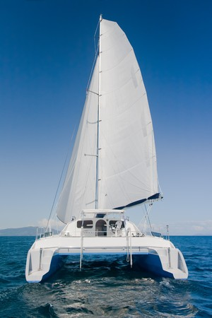 catamaran: Luxury white catamaran boat in the ocean with blue sky