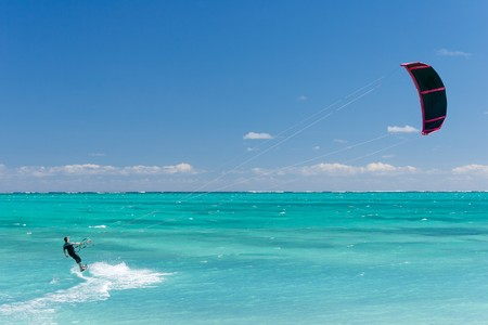 Male kitesurfer kitesurfing in the lagoon of Madagascar