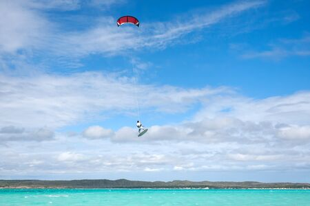 Male kitesurfer jumping in the lagoon of Babaomby, Madagascar photo
