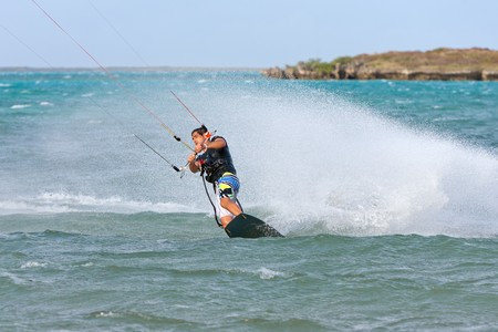 Male kitesurfer enjoying his sport in the lagoon of Babaomby, Madagascar photo