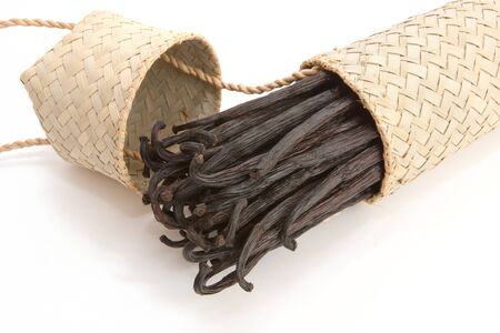 Boot of Bourbon vanilla beans in its case craft isolated on white background photo