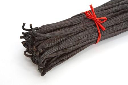 Boot of Bourbon vanilla beans isolated on white background photo