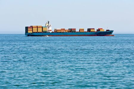 Vessel loaded cargo containers in the Pacific Ocean photo