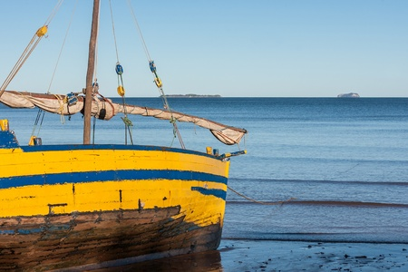 dugout: Malagasy dhow at low tide of Analalava, western Madagascar Stock Photo