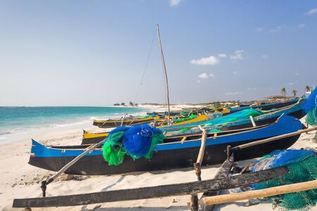 Fishing canoes on the beach of Itampolo, southern Madagascar photo