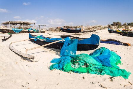 dugout: Fishing canoes on the beach of Itampolo, southern Madagascar Stock Photo