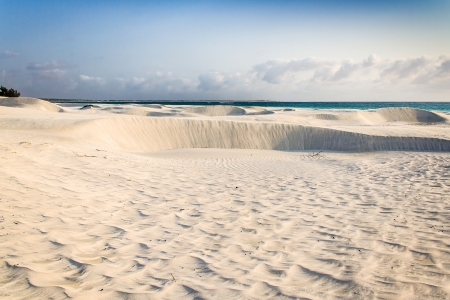White sand dune by the sea in southern Madagascar photo