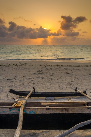 dugout: Fishing dugout before the sunset in the great south of Madagascar Stock Photo