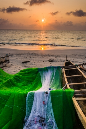Fishing dugout before the sunset in the great south of Madagascar photo