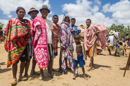 ITAMPOLO, MADAGASCAR - OCT 19: Group of Malagasy mens unidentified of ethnic Antandroy in the weekly market of Itampolo in the deep south of Madagascar on october 19, 2006. Antandroy are a nomadic ethnic group of Androy region, and live mainly from fishin